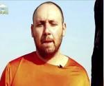 Imagen de un vídeo realizado por el Estado Islámico (EI) facilitada hoy, martes 2 de septiembre de 2014, que muestra al periodista estadounidense Steven Sotloff antes de ser ejecutado hoy. EFE