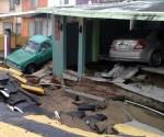 Vista de varias casas afectadas hoy, martes 2 de septiembre de 2014, por las intensas lluvias debido a la tormenta tropical Dolly en la ciudad de Xalapa del estado mexicano de Veracruz. EFE